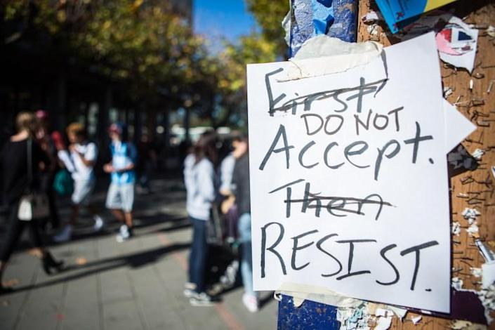 """Signs across California campus asking students to """"First Accept, Then Resist"""" were vandalized to convey, """"Do Not Accept. Resist."""" Protests continued throughout the campus on Nov. 9, 2016, in Berkeley, Calif. (Rachael Garner/The Daily Californian)"""