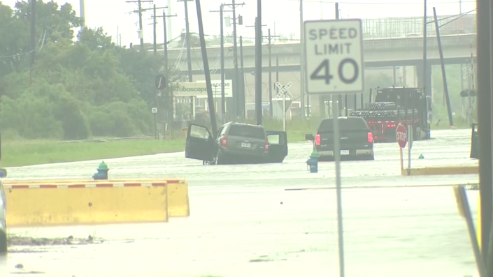 Drivers abandon their cars as Tropical Storm Beta floods roads in Houston. / Credit: KHOU