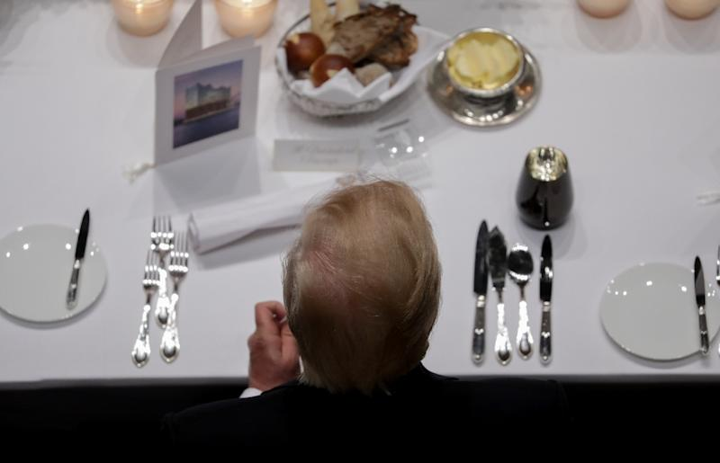 US President Donald Trump attends the banquet after a concert at the Elbphilharmonie concert hall during the G20 Summit in Hamburg, Germany, on July 7, 2017 (AFP Photo/Kay Nietfeld)