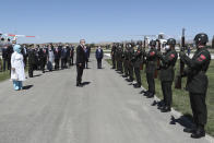 Turkey's President Recep Erdogan inspects a military honour guard as he arrives to attend celebrations marking the anniversary of the 1071 battle of Manzikert, during which Turkish Seljuks beat Byzantine forces, gaining entry into Anatolia, in Malazgirt, eastern Turkey, Wednesday, Aug. 26, 2020. Erdogan warned Greece on Wednesday not to test his country's patience or courage, further stoking tensions between the NATO allies over offshore energy exploration in the eastern Mediterranean.(Turkish Presidency via AP, Pool)