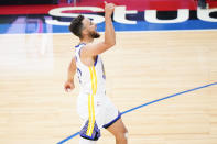 Golden State Warriors' Stephen Curry reacts after making a three-pointer during the second half of an NBA basketball gameagainst the Philadelphia 76ers, Monday, April 19, 2021, in Philadelphia. (AP Photo/Matt Slocum)