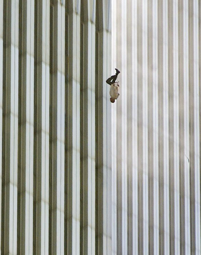 """Was the """"Falling Man"""" ever identified?<br><br>The identity of the man from photographer Richard Drew's iconic 9/11 image has never been revealed. However, several possibilities are discussed in Tom Junod's <a href=""""http://www.esquire.com/features/ESQ0903-SEP_FALLINGMAN%20"""" rel=""""nofollow noopener"""" target=""""_blank"""" data-ylk=""""slk:renowned 2003 Esquire piece"""" class=""""link rapid-noclick-resp"""">renowned 2003 Esquire piece</a> that coined the title of the photo.<br><br>Photo: In this Tuesday, Sept. 11, 2001 file picture, a person falls headfirst from the north tower of New York's World Trade Center. (AP Photo/Richard Drew)"""