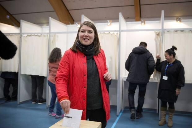 Sara Olsvig, leader of Inuit Ataqatigiit, casts her vote at a polling station in Nuuk in 2018. The party could potentially gain from opposition to the Kannersuit mine in southern Greenland, where the Siumut party often leads.