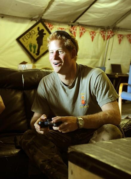 Prince Harry plays computer games at Camp Bastion in Afghanistan's Helmand Province on November 3, 2012. Harry said he killed Taliban fighters during his stint as a helicopter gunner in Afghanistan, in comments that can be reported after he completed his tour of duty