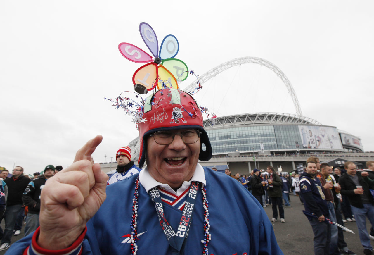 """Fan Jack """"Bo"""" Kennedy of Andover, Massachusetts, a Patriots season ticket holder for 43 years waits outside the stadium before the NFL football game between the St. Louis Rams and the New England Patriots at Wembley Stadium in London, October 28, 2012.   REUTERS/Suzanne Plunkett (BRITAIN  - Tags: SPORT FOOTBALL)"""