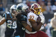 Carolina Panthers free safety Tre Boston tackles Washington Redskins tight end Jeremy Sprinkle (87) during the first half of an NFL football game in Charlotte, N.C., Sunday, Dec. 1, 2019. (AP Photo/Brian Blanco)