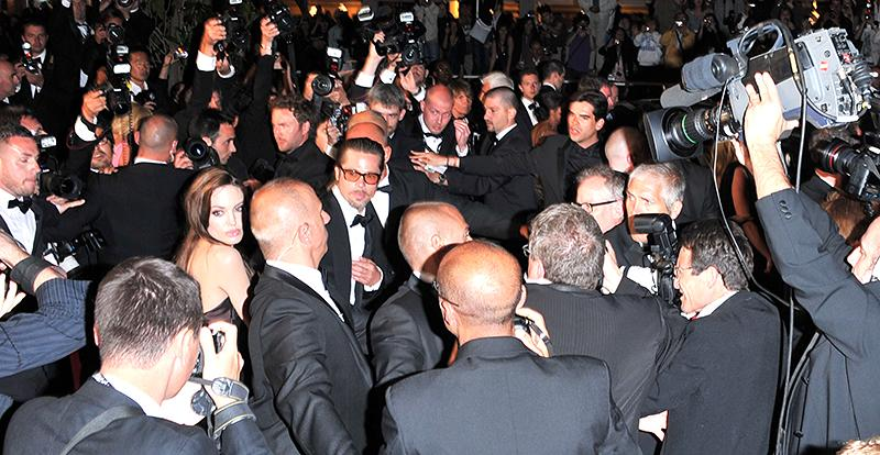 Angelina Jolie and Brad Pitt are swarmed by cameras at the 2011 Cannes Film Festival. (Photo: George Pimentel/FilmMagic)