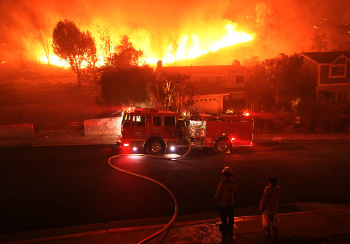 The out-of-control Woolsey Fire rages behind a house in the West Hills neighborhood of Los Angeles, Nov. 9, 2018. (Photo: Kevork Djansezian/Getty Images)