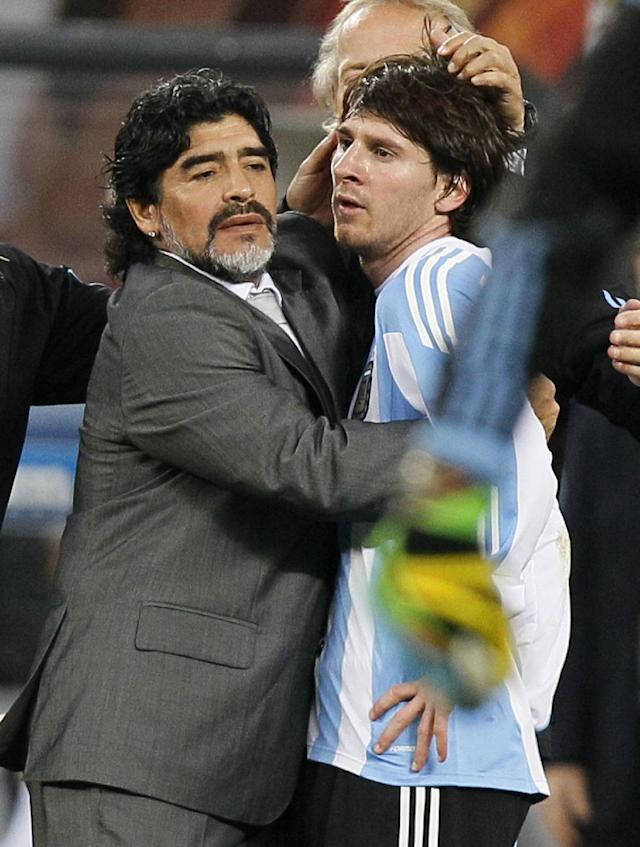 FILE - The July 3, 2010 file photo shows Argentina's Lionel Messi, right, as he is comforted by Argentina head coach Diego Maradona, left, following the World Cup quarterfinal soccer match between Argentina and Germany at the Green Point stadium in Cape Town, South Africa, Saturday, July 3, 2010. Germany won 4-0. On Sunday, July 13, 2014, Germany and Argentina will face each other again in the final of the 2014 soccer World Cup. (AP Photo/Ricardo Mazalan)