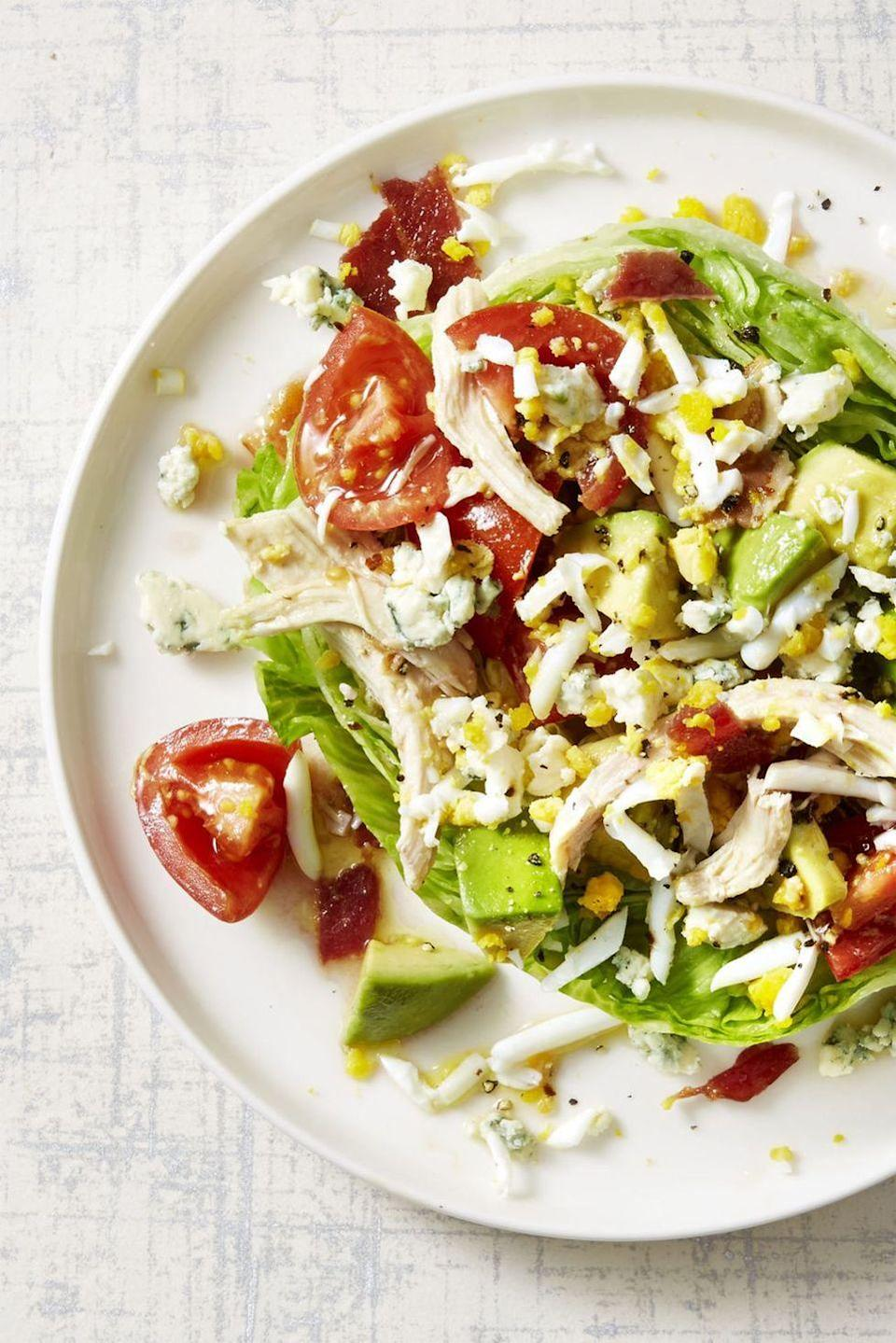 """<p>Crispy bacon, tender chicken, crumbled cheese, and chopped eggs prove that not all salads have to be boring.</p><p><em><a href=""""https://www.goodhousekeeping.com/food-recipes/easy/a45233/rotisserie-chicken-cobb-salad-recipe/"""" rel=""""nofollow noopener"""" target=""""_blank"""" data-ylk=""""slk:Get the recipe for Rotisserie Chicken Cobb Salad »"""" class=""""link rapid-noclick-resp"""">Get the recipe for Rotisserie Chicken Cobb Salad »</a></em></p><p><strong>RELATED:</strong> <a href=""""https://www.goodhousekeeping.com/food-recipes/healthy/g180/healthy-salads/"""" rel=""""nofollow noopener"""" target=""""_blank"""" data-ylk=""""slk:31 Healthy Salads for a Very Filling, Very Un-boring Meal"""" class=""""link rapid-noclick-resp"""">31 Healthy Salads for a Very Filling, Very Un-boring Meal</a></p>"""