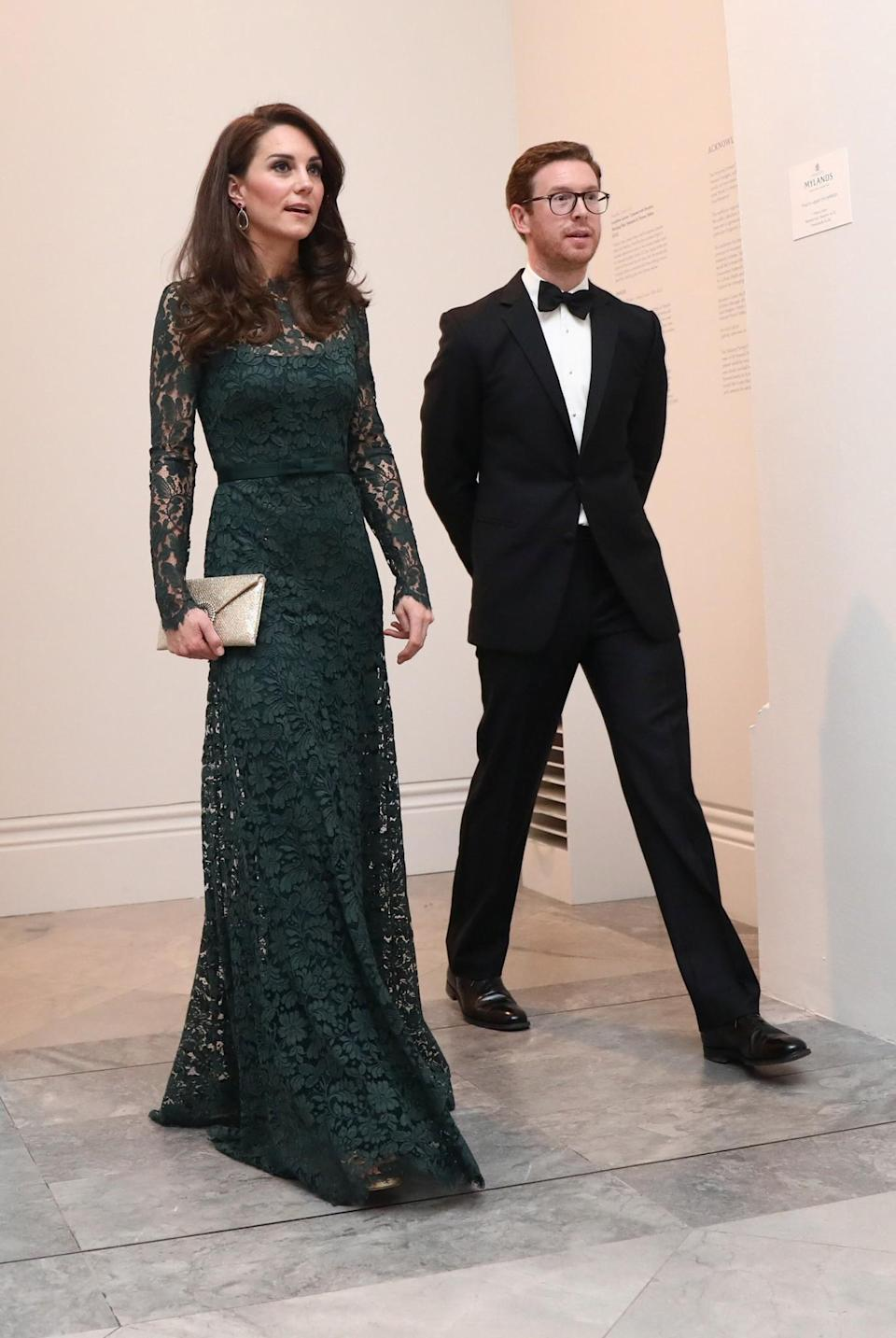 <p>Kate was a complete vision in an emerald lacy gown by Temperley London. Attending her second National Portrait Gala, the Duchess stole the show in the floor-length look accompanied by golden accessories: a glitter clutch by Wilbur and Gussie and strappy Jimmy Choo sandals.<br><i>[Photo: PA]</i> </p>