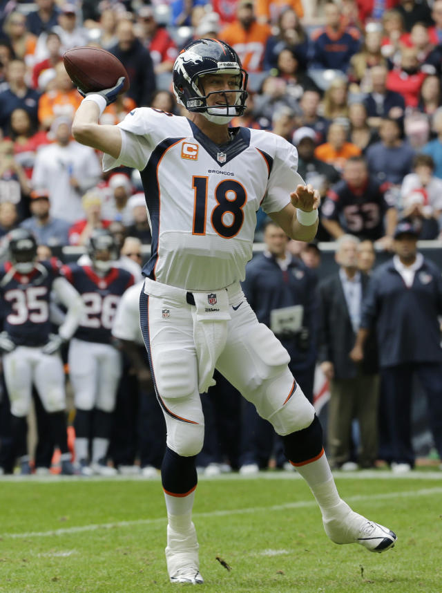 Denver Broncos' Peyton Manning throws against the Houston Texans during the first quarter of an NFL football game on Sunday, Dec. 22, 2013, in Houston. (AP Photo/David J. Phillip)