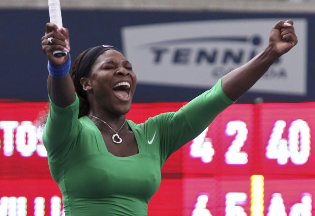 Serena Williams of the United States celebrates her victory over Samantha Stosur of Australia in the final at the Rogers Cup WTA event in Toronto, Ontario, August 14, 2011. AFP PHOTO/Geoff Robins (Photo credit should read GEOFF ROBINS/AFP/Getty Images)