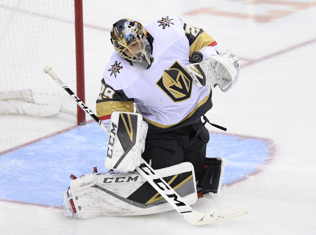 Vegas Golden Knights goaltender Marc-Andre Fleury stops the puck during the third period of the team's NHL hockey game against the Washington Capitals, Wednesday, Oct. 10, 2018, in Washington. The Capitals won 5-2. (AP Photo/Nick Wass)