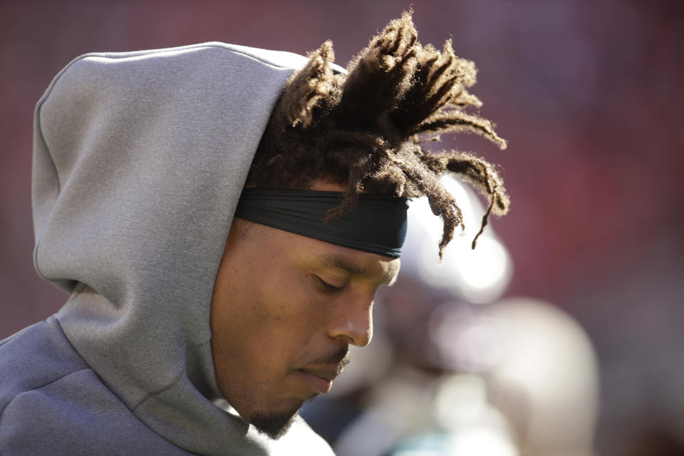 Carolina Panthers quarterback Cam Newton is visiting a foot specialist to learn why his injury isn't improving. (AP/Ben Margot)