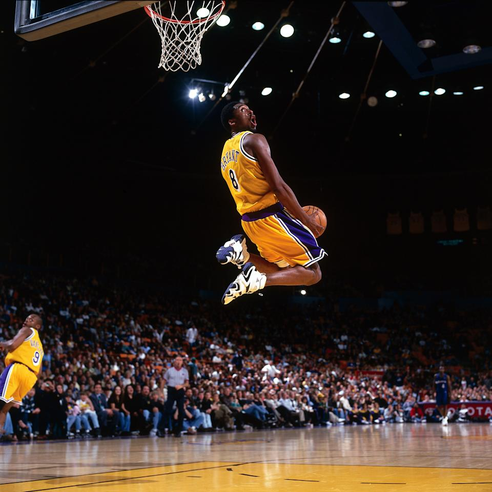 Kobe Bryant surgically executed opponents with footwork and skill as he honed his craft over a 20-year NBA career, but never forget he entered the NBA as an electric athlete — captured here in a January 1998 win over the Minnesota Timberwolves. (Andrew D. Berstein/NBAE via Getty Images)