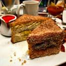 """<p><strong>Where to Get It: </strong>Disney's Polynesian Resort's Kona Cafe ($16) as well as at the counter-service location downstairs, Captain Cook's ($8.49) <strong>Lou's Review: """"</strong>Truly the best French Toast you'll ever eat. Imagine a 2-inch thick piece of banana-stuffed, deep-fried, custard-soaked bread…now sprinkle it with sugar and put some strawberry compote and macadamia nut butter on the side. Unreal!""""</p>"""