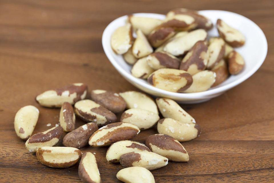 """<p>Brazil nuts are high in selenium. In fact, one nut delivers more than an entire day's worth, according to <a href=""""http://www.berkeleywellness.com/healthy-eating/food/article/brazil-nuts-super-source-selenium"""" rel=""""nofollow noopener"""" target=""""_blank"""" data-ylk=""""slk:Berkeley Wellness"""" class=""""link rapid-noclick-resp"""">Berkeley Wellness</a>.</p><p><strong>Recipe to try: </strong><a href=""""https://www.womansday.com/food-recipes/food-drinks/recipes/a20962/mixed-nuts-with-honey-and-mascarpone/"""" rel=""""nofollow noopener"""" target=""""_blank"""" data-ylk=""""slk:Mixed Nuts With Honey and Mascarpone"""" class=""""link rapid-noclick-resp"""">Mixed Nuts With Honey and Mascarpone</a></p>"""