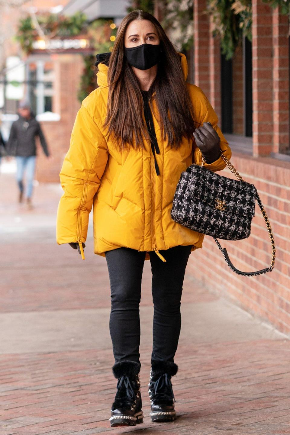 <p>Kyle Richards is bundled up in yellow for a solo shopping trip in Aspen on Sunday.</p>