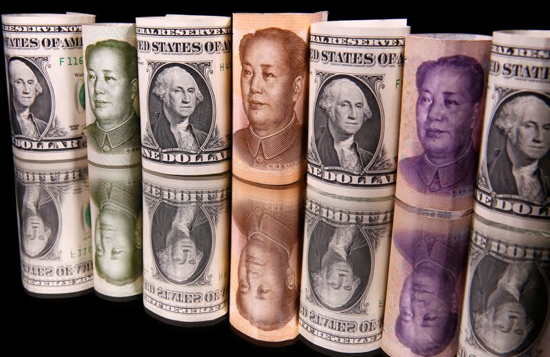 Chinese Yuan and U.S. dollar banknotes are seen in this illustration