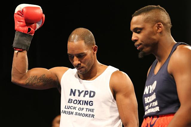 <p>New York's Finest Thomas Boatswain celebrates victory over fellow officer David Chestnut at the NYPD Boxing Championships at the Theater at Madison Square Garden on June 8, 2017. (Photo: Gordon Donovan/Yahoo News) </p>