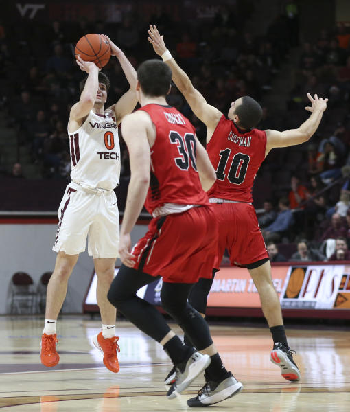 Viginia Tech's Hunter Cattoor (0) shoots a three-point basket and is fouled while defended by Virginia Military Institute's Kamdyn Curfman (10) and Sean Conway (30) in the second half of an NCAA college basketball game Saturday, Dec. 21 2019, in Blacksburg, Va. (Matt Gentry/The Roanoke Times via AP)