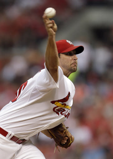 St. Louis Cardinals starting pitcher Adam Wainwrightt throws during the first inning of a baseball game against the Milwaukee Brewers on Friday, Aug. 1, 2014, in St. Louis. (AP Photo/Jeff Roberson)
