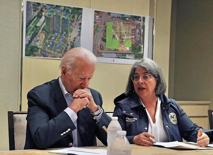 Miami-Dade County Mayor Daniella Levine Cava confers with President Joe Biden during a meeting with officials at the St. Regis Resort in Bal Harbour on Thursday, July 1, 2021.