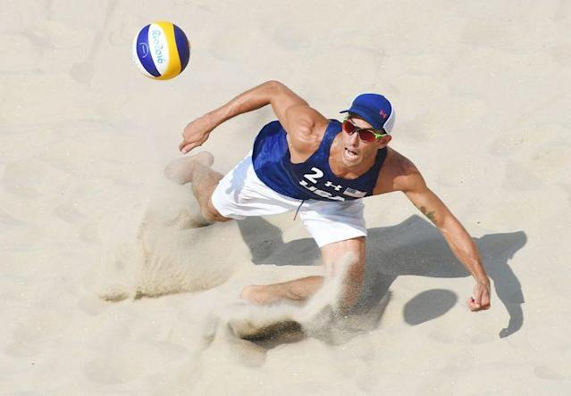 USA's Nicholas Lucena eyes the ball during the men's beach volleyball qualifying match between the USA and Mexico at the Beach Volley Arena in Rio de Janeiro on August 9, 2016, for the Rio 2016 Olympic Games. / AFP / Yasuyoshi Chiba (Photo credit should read YASUYOSHI CHIBA/AFP/Getty Images)