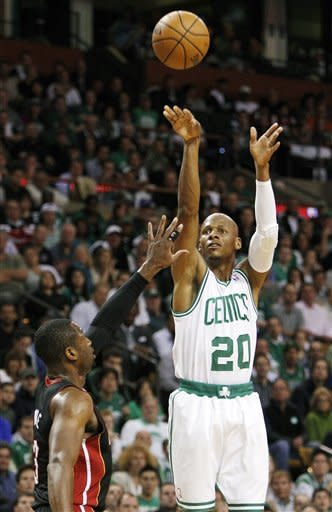 Boston Celtics guard Ray Allen (20) shoots a 3-pointer over Miami Heat guard Dwyane Wade (3) during the first quarter of Game 4 in their NBA basketball Eastern Conference finals playoff series in Boston, Sunday, June 3, 2012. (AP Photo/Elise Amendola)
