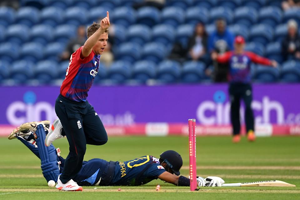 Sam Curran celebrates his side-footed run out (Getty Images)