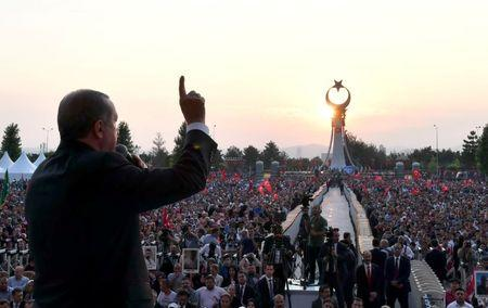 Turkish President Tayyip Erdogan addresses his supporters during a ceremony marking the first anniversary of the attempted coup at the Presidential Palace in Ankara