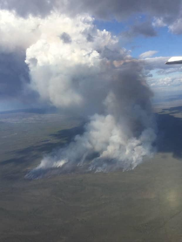 This photo shows a previous wildfire in the Dehcho region earlier this summer. The current fire threatening cabins began in the last 24 hours.  (N.W.T. Department of Environment and Natural Resources - image credit)