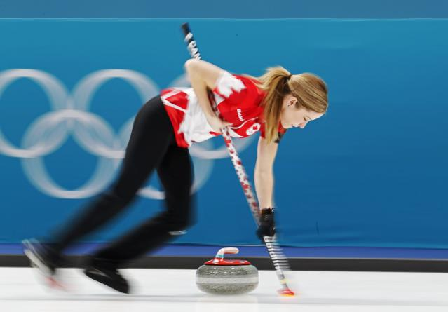 <p>Kaitlyn Lawes of Canada sweeps. REUTERS/Cathal McNaughton </p>