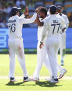 India's Thangarasu Natarajan, centre, is congratulated by teammates after dismissing of Australia's Marnus Labuschagne during play on the first day of the fourth cricket test between India and Australia at the Gabba, Brisbane, Australia, Friday, Jan. 15, 2021. (AP Photo/Tertius Pickard)