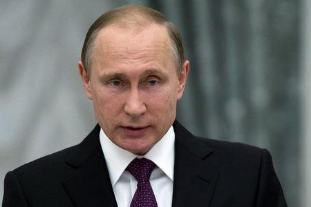 Russian President Vladimir Putin delivers a speech during a state awarding ceremony at the Kremlin in Moscow