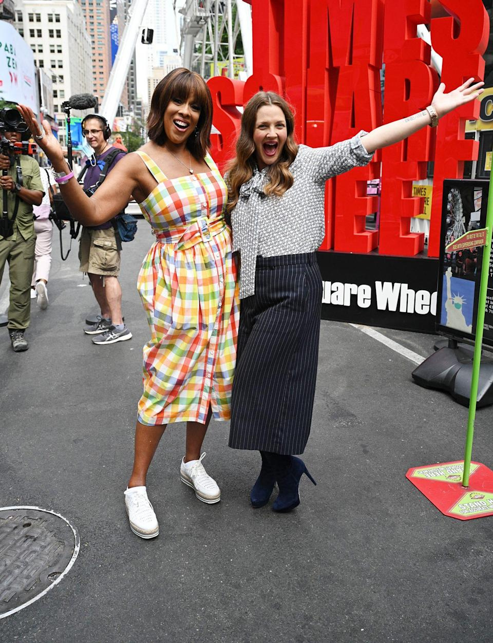 <p>Gayle King and Drew Barrymore go for a ride on the ferris wheel in Times Square on Aug. 31 in N.Y.C. </p>