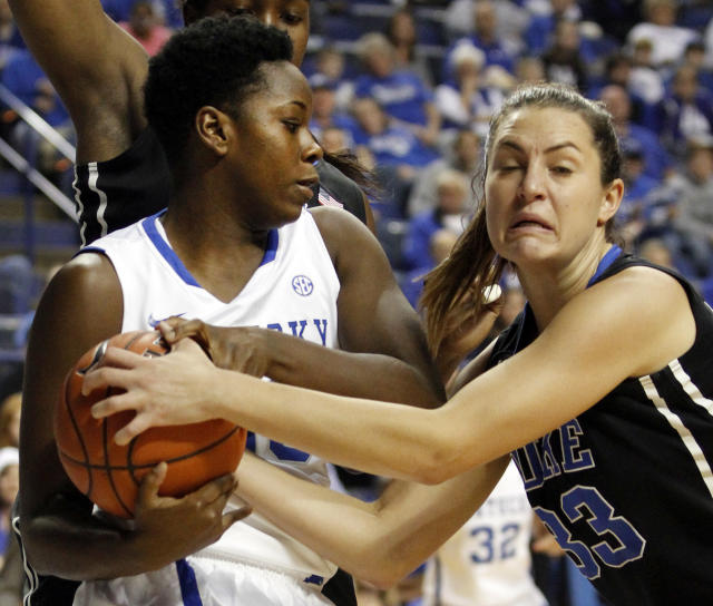 Kentucky's Samarie Walker, left, is tied up by Duke's Haley Peters during the first half of an NCAA college basketball game, Sunday, Dec. 22, 2013, in Lexington, Ky. Kentucky won 93-80. (AP Photo/James Crisp)