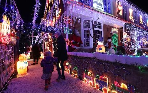 A house covered in lights in New Milton, Hampshire - Credit: Andrew Matthews/PA