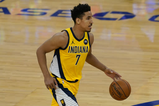 Indiana Pacers guard Malcolm Brogdon (7) dribbles the ball up the court against the Golden State Warriors during the first half of an NBA basketball game in San Francisco, Tuesday, Jan. 12, 2021. (AP Photo/Jeff Chiu)
