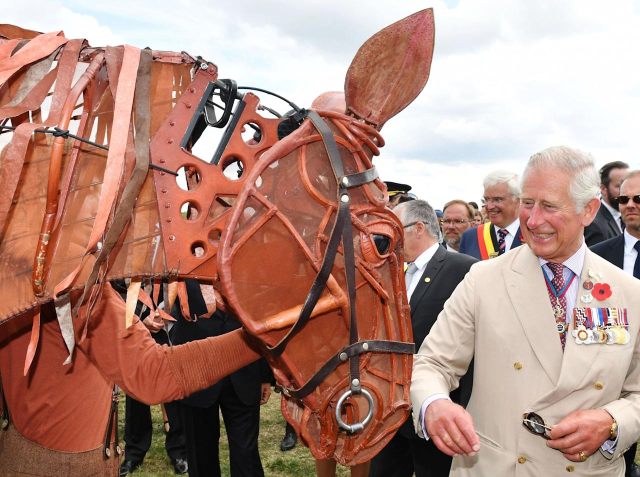 <p></p><p><span>Prince Charles meets a mechanical War Horse a remembrance event for the </span><span>100th Anniversary of Passchendaele. (Rex features)</span> </p><p></p>