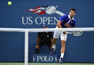 Novak Djokovic returns the ball to Marin Cilic during their 2015 US Open Men's singles semifinals match in New York on September 11, 2015 (AFP Photo/Jewel Samad)