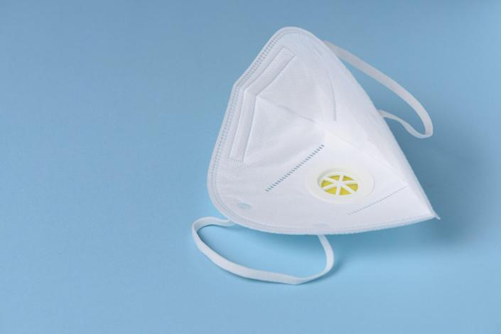 A disposable respirator with breathing valve.