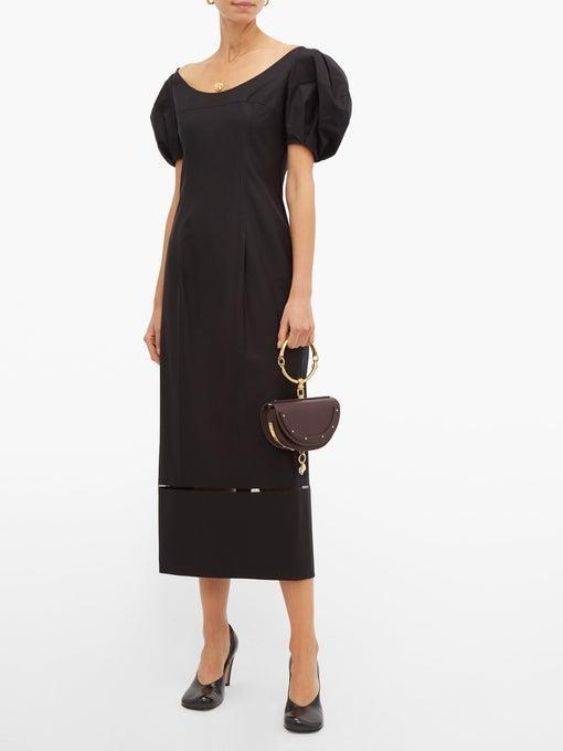 """Unfortunately, I couldn't find quite the same discount level for you guys as I managed for myself, but here's the same dress for 40% off. If you're looking for something equally as stylish, though, for a fraction of the cost, here's <a href=""https://www.zara.com/us/en/textured-weave-dress-p04786071.html?v1=34091601&v2=1445722"" rel=""nofollow noopener"" target=""_blank"" data-ylk=""slk:a similar LBD from Zara for under-$90"" class=""link rapid-noclick-resp"">a similar LBD from Zara for under-$90</a>. Shop away."" <br> <br> <strong>Khaite</strong> Allison Puff-Sleeve Cotton Midi Dress, $, available at <a href=""https://go.skimresources.com/?id=30283X879131&url=https%3A%2F%2Fwww.matchesfashion.com%2Fus%2Fproducts%2F1282447"" rel=""nofollow noopener"" target=""_blank"" data-ylk=""slk:Matches Fashion"" class=""link rapid-noclick-resp"">Matches Fashion</a>"