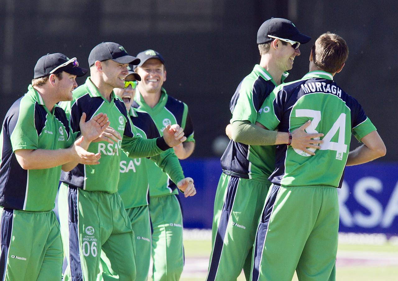 Ireland's Tim Murtagh celebrates with team-mates after bowling England's James Taylor during the One Day International at The Village, Dublin.