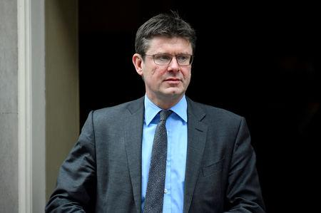Britain's Secretary of State for Business Greg Clark leaves Downing Street in London