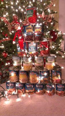 "<p>Set up your elf with some non-perishable goods and a note suggesting you all make a trip to drop them off at the food bank. You could also do this with gifts to donate to a toy drive.</p> <p>Source: <a href=""http://2.bp.blogspot.com/-KI-qcIqHraA/UMU6ibrW1AI/AAAAAAAABnE/H_o2hU2zYWU/s400/IMAG0063.jpg"" target=""_blank"">Blogspot</a></p>"