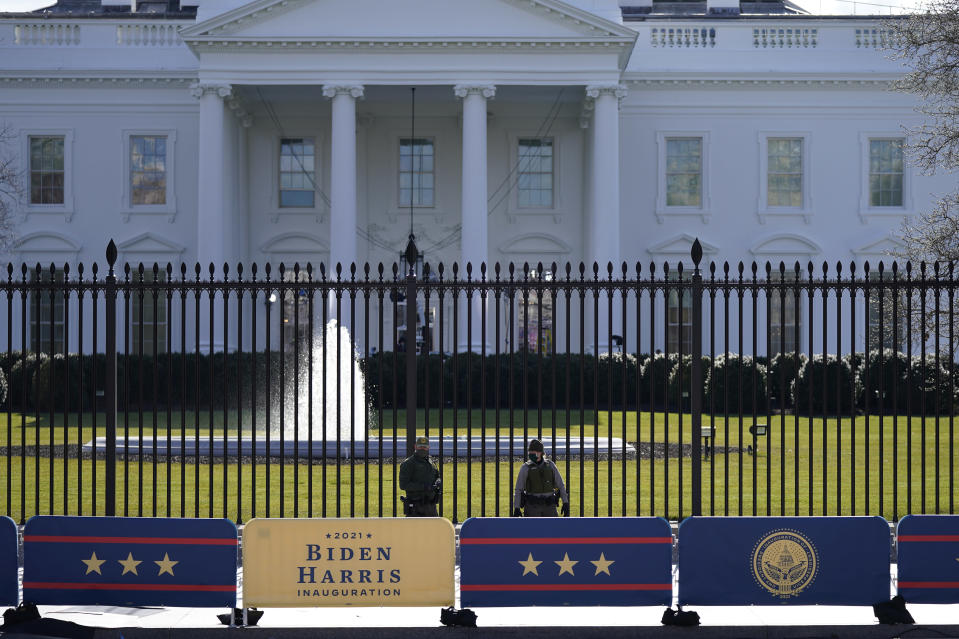 A security team patrols in front of the White House as preparations continue ahead of President-elect Joe Biden's inauguration ceremony, Tuesday, Jan. 19, 2021, in Washington. (AP Photo/David Phillip)