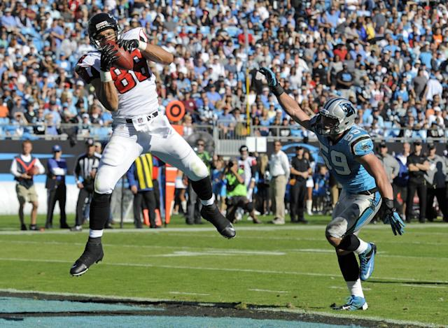 Atlanta Falcons' Tony Gonzalez (88) catches a touchdown pass as Carolina Panthers' Luke Kuechly (59) defends in the first half of an NFL football game in Charlotte, N.C., Sunday, Nov. 3, 2013. (AP Photo/Mike McCarn)