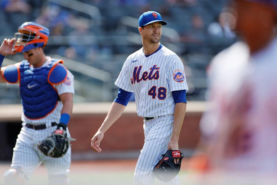 Jacob deGrom walks off the mound in the eighth inning.
